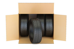 Cardboard Box with Tires closeup, 3D rendering Stock Photography