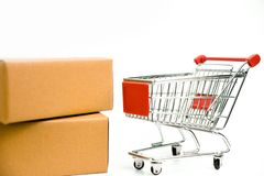 Cardboard box and trolley cart on isolated white background stock photo