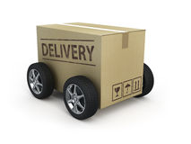 Cardboard box with wheels. Delivery concept Royalty Free Stock Photos