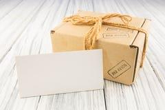 Cardboard box. On white wood background Royalty Free Stock Image