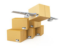 Cardboard box with wings Stock Photos