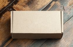Cardboard box on a wooden background Royalty Free Stock Photo