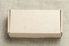 Cardboard box on a wooden background Royalty Free Stock Image