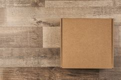Cardboard box on floor. Cardboard box on wooden floor royalty free stock photos