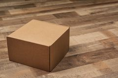 Cardboard box on floor. Cardboard box on wooden floor stock photo