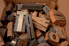 Cardboard box with wooden letters. Cardboard box with lots of wooden typescript letters Stock Images