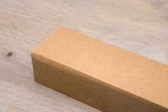 Cardboard box on wooden table background. Template of long box for your design. Recycled product packaging stock images