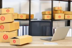 Cardboard box on workplace at home. Start up small business.  royalty free stock photography