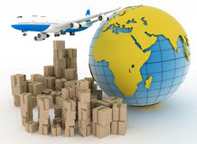Cardboard boxes and airplane in the globe background Stock Photo