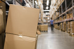 Cardboard boxes in the aisle Royalty Free Stock Images