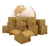 Cardboard boxes on the background of the earth Stock Image