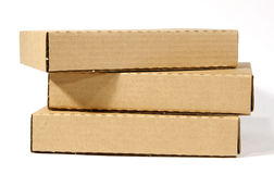 Cardboard boxes. Closed cardboard packages on white background Stock Images