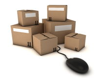 Cardboard boxes and computer mouse. Shopping online, moving house or business, suits for many concepts Royalty Free Stock Photo