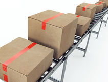 Cardboard boxes on conveyor belt Royalty Free Stock Image