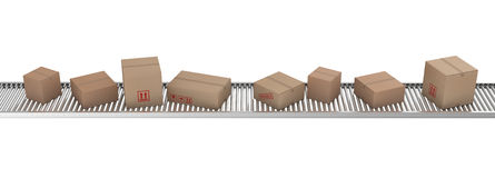 Cardboard boxes on conveyor belt Royalty Free Stock Photos