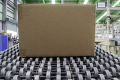 Cardboard boxes on conveyor belt. In distribution warehouse stock photography