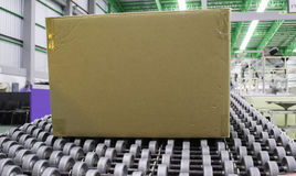 Cardboard boxes on conveyor belt. In distribution warehouse royalty free stock photography
