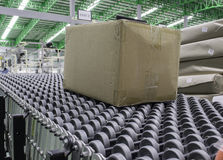 Cardboard boxes on conveyor belt in distribution warehouse. Cardboard boxes on conveyor belt in distribution warehouse royalty free stock photo