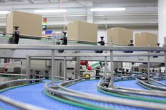 Cardboard boxes on conveyor belt in factory royalty free stock photos