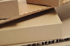 Cardboard boxes and corrugated cardboard Stock Images