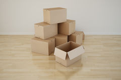 Cardboard boxes in empty room Stock Photography