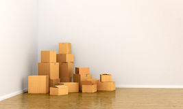 Cardboard boxes in empty room. Royalty Free Stock Photos