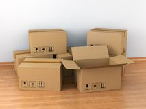 Cardboard boxes in empty room Royalty Free Stock Image