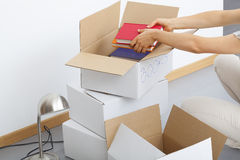 Cardboard boxes filling stock photo