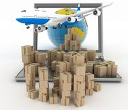 Cardboard boxes, globe on a laptop screen and airplane Stock Photos