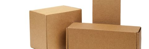 Cardboard boxes for goods on a white background. Different size. Isolated on white background royalty free stock image