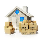 Cardboard boxes and home Stock Photography