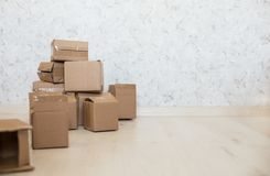 Cardboard boxes on laminate floor Stock Photography