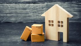 Cardboard boxes near the house. The concept of moving to another house, relocation. Transportation of property and goods. Home delivery. Shopping online stock photos