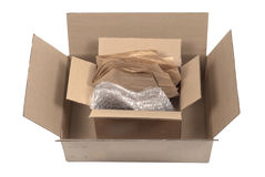 Cardboard Boxes and Packaging. Two used cardboard boxes with bubble wrap and brown paper for shipping. White Background royalty free stock images