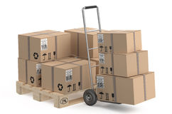 Cardboard boxes on pallet and hand truck Stock Images