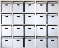 Cardboard boxes on shelves Stock Photos