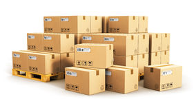 Cardboard boxes on shipping pallets. Creative abstract cargo, delivery and transportation logistics storage warehouse industry business concept: group of stacked Royalty Free Stock Images