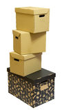 Cardboard boxes stack. Black and brown cardboard boxes stack for a moving day Royalty Free Stock Image