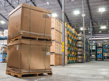 Cardboard boxes in a store warehouse automotive parts. Royalty Free Stock Images