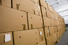 Cardboard boxes in the storehouse Stock Images
