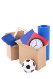 Cardboard boxes with stuff ready for moving day isolated on whit Stock Images