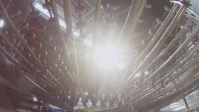 Cardboard boxes transported by conveyor belt low angle shot. New cardboard boxes blocks transported by conveyor belt with metal rollers in workshop low angle stock footage