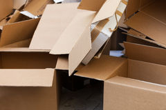 Cardboard boxes in trash Stock Photo