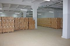 Cardboard boxes warehouse Royalty Free Stock Photos
