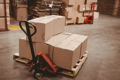 Cardboard boxes in warehouse Stock Photos