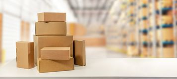 Cardboard boxes in warehouse ready for transportation. And delivery. copy space royalty free stock image