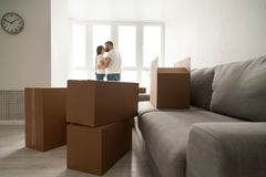 Free Cardboard Boxes With Kissing Couple At Background, Moving Day Co Stock Image - 108402471