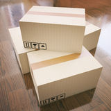 Cardboard boxes on wooden floor Stock Photo