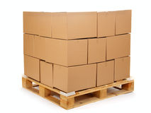Cardboard boxes on wooden palette Royalty Free Stock Images
