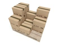 Cardboard boxes on wooden palette isolated on white Royalty Free Stock Photo
